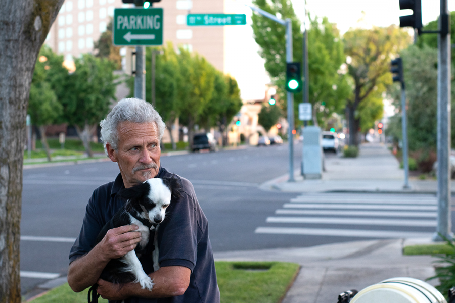 1.	Randy is pictured cradling his beloved dog, Tareyton. Randy had mentioned not speaking with his family in twenty-one years. May 2nd, 2019. Modesto, CA.