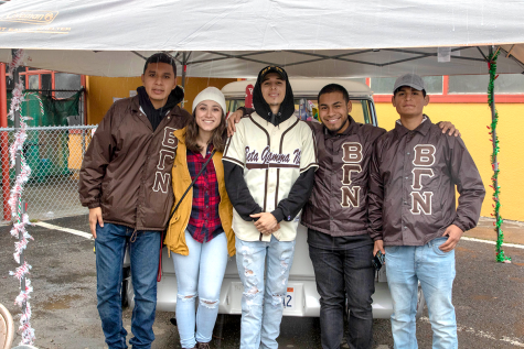 Beta Gamma Nu Fraternity, from California State University, East Bay attended the Rides for Toys Car Show event where they gave back to the community by donating toys. From left to right: Sergio Sorto, Mayra Mora, Andrew Perez, Manual Jose Rendon, and Hector Valdivia.