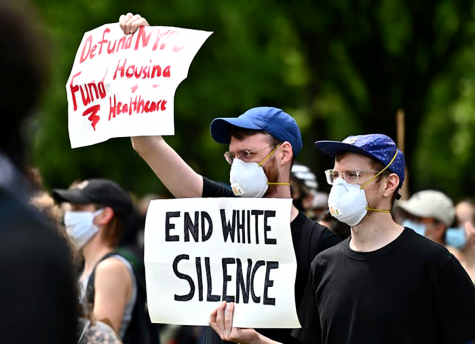 Protesters hold up signs during a Black Lives Matter protest in New York City, on June 3, 2020.