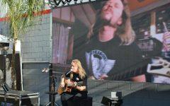 Musician Aaron Pearson performs at neighborhood outdoor bar, Retro Junkie