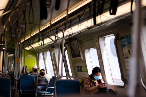 BART riders on the San Francisco/Daly City rail on April 28 seen wearing masks and socially distanced, following the recommendations set by the CDC to reduce the spread of Covid-19.