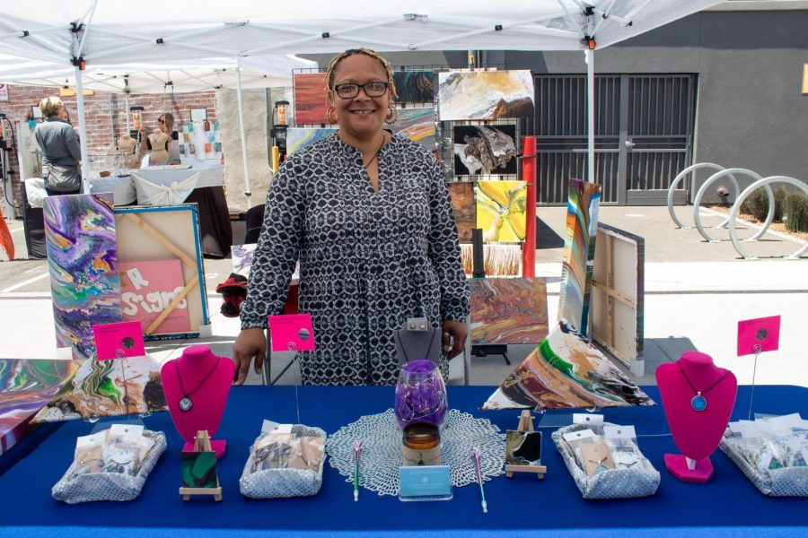 Charmeng Robinson (owner of Star Designs by Charmeng) stood for a photo in her stall at the flea market.